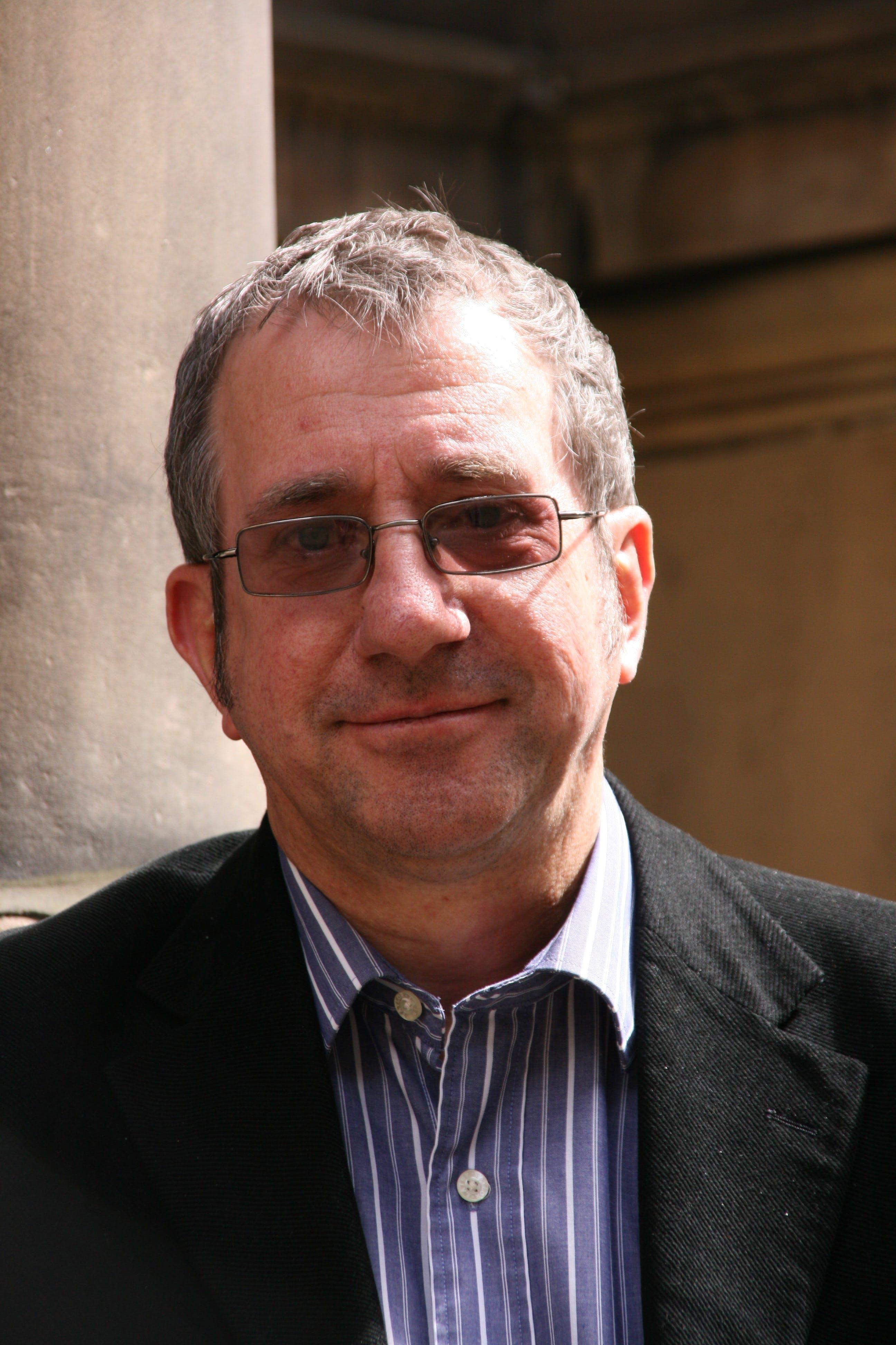 Dr John Philip Kitchen, MA BMus PhD  FRCO LRAM