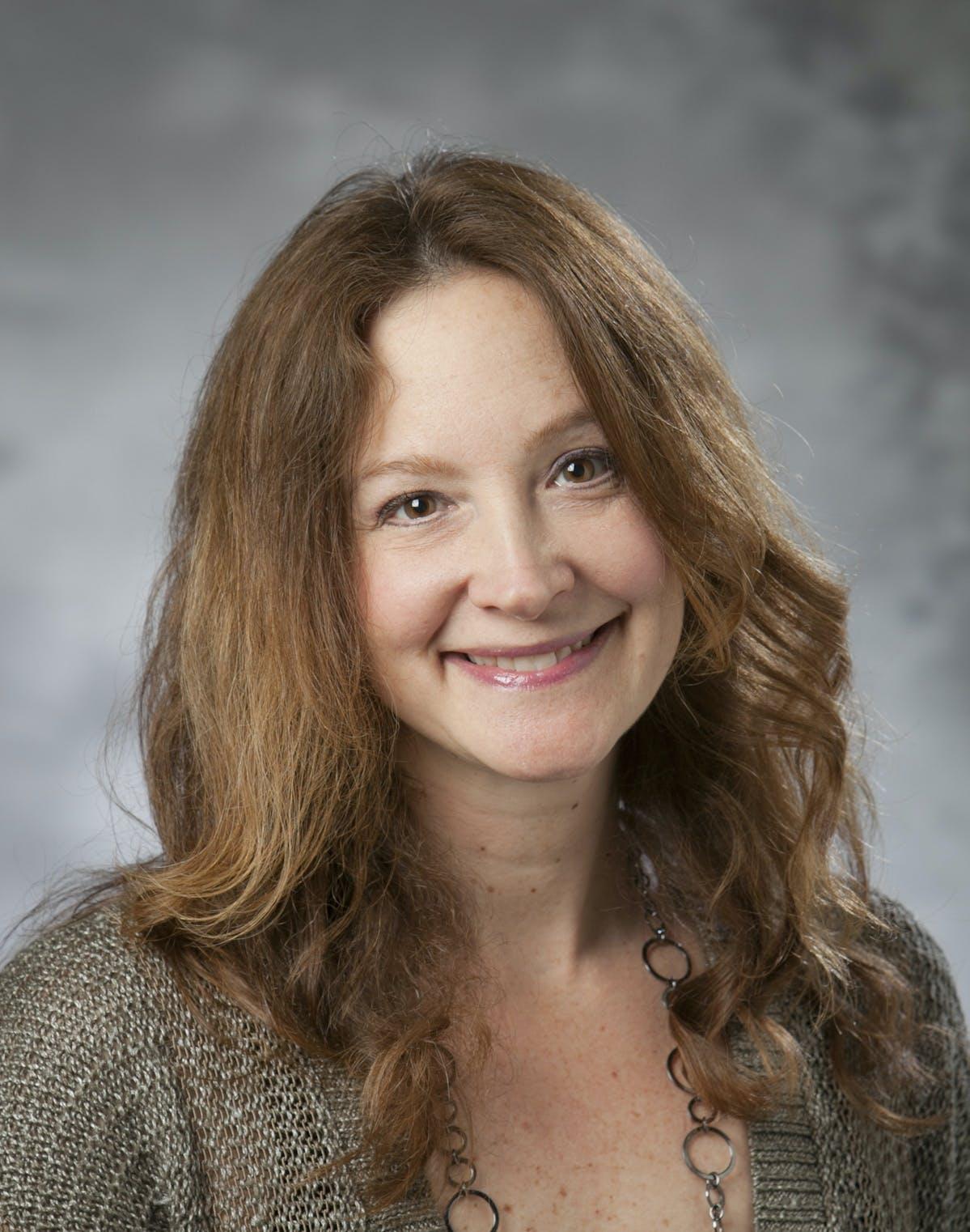 Dr. Denise Comer