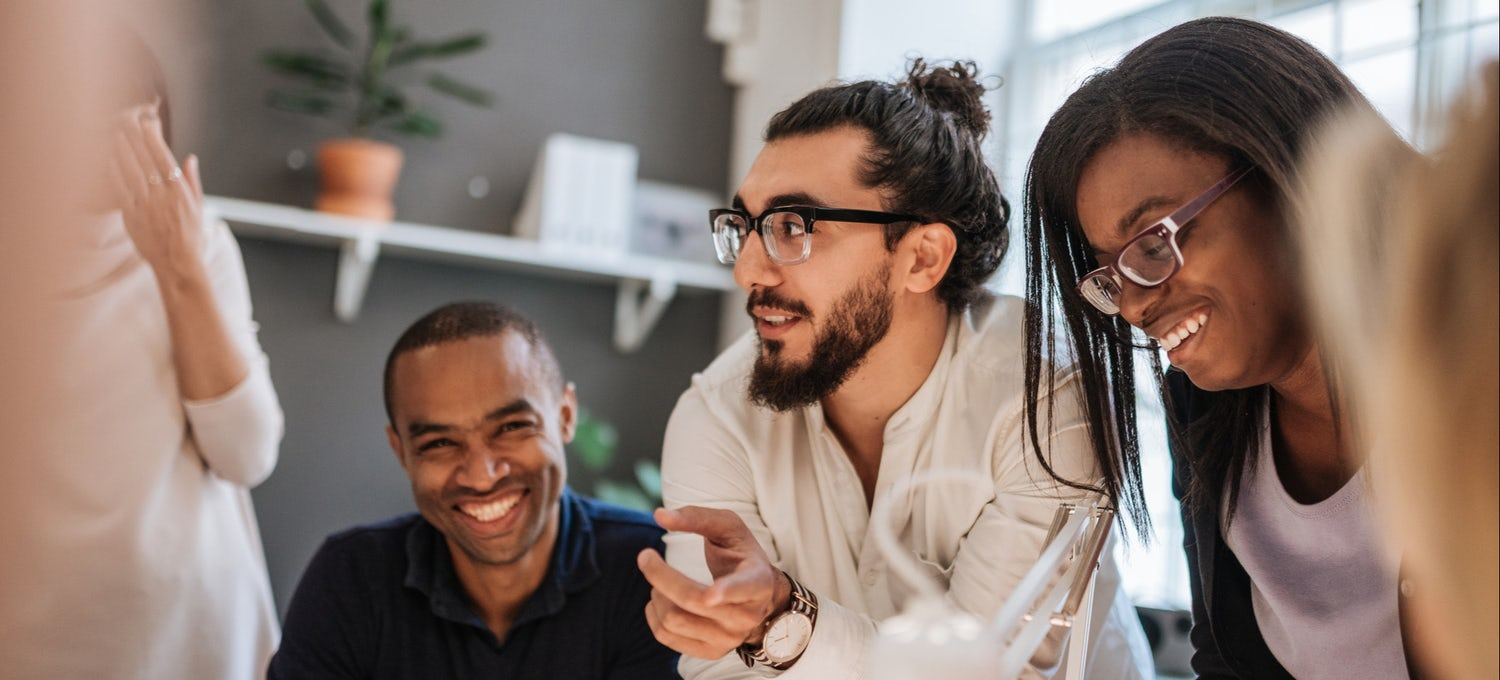 An IT project manager discusses a roll-out plan with his team